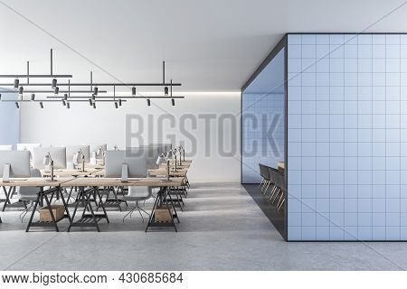 Modern Coworking Office Interior With Blue Tile Partition, Equipment, Furniture And Daylight. 3d Ren