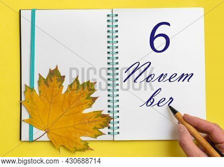 6th Day Of November. Hand Writing The Date 6 November In An Open Notebook With A Beautiful Natural M