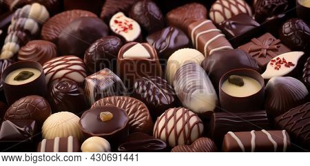 Chocolate Candy And Bonbon With Various Fillings. Sweet Food, Chocolate Background