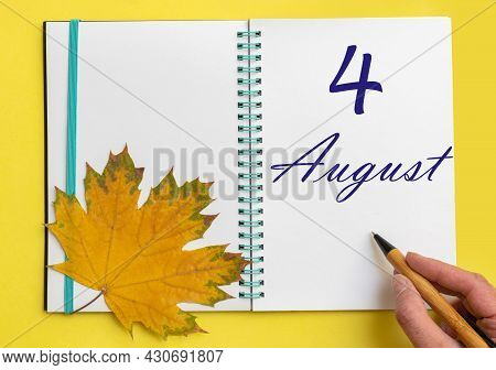4th Day Of August. Hand Writing The Date 4 August In An Open Notebook With A Beautiful Natural Maple