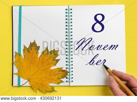 8th Day Of November. Hand Writing The Date 8 November In An Open Notebook With A Beautiful Natural M