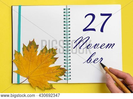 27th Day Of November. Hand Writing The Date 27 November In An Open Notebook With A Beautiful Natural