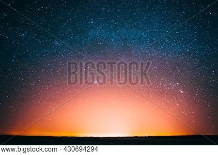 Amazing Beautiful Night Sky Glowing Stars Background Backdrop With Colorful Sky Gradient. Sunset Sun