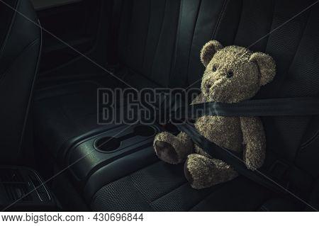 Child Car Transportation Safety Theme. Teddy Bear On A Backseat With Fasten Seat Belt.