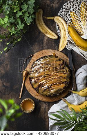 Upside Down Banana Cake With Caramel On A Wooden Table