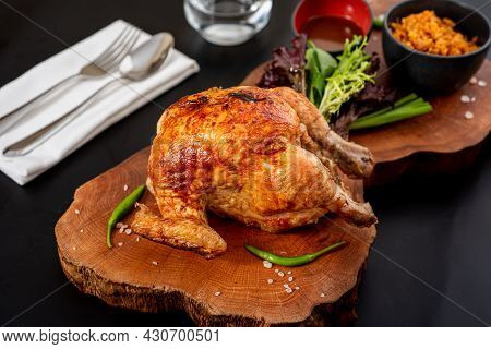 Roasted Whole Chicken Cooked On Charcoal With Bulgur Pilaf On Wooden Board.