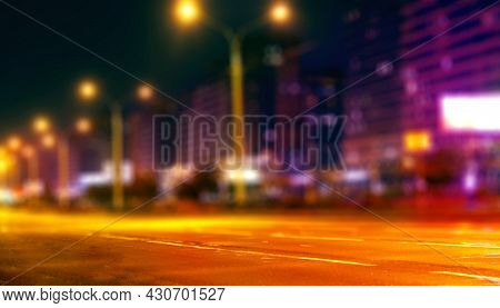 Blurred City Background At Night. City Night Lights In Neon Colors.