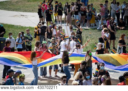 Cluj-Napoca, Romania - August 22, 2021: Equality parade on the streets of Cluj-Napoca. Gay, lesbians, trans, hetero people in LGBT Pride Parade.