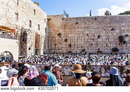 JERUSALEM, ISRAEL - NOVEMBER 16, 2011: Great religious Jewish holiday. The Temple Mount. The Western Wall - place of faith and pilgrimage for Jews around the world.