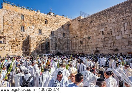JERUSALEM, ISRAEL - SEPTEMBER 26, 2018: Touching ceremony at the Western Wall. Jews praying at the Western Wall wrapped in festive white Talit. The blessing of the Cohanim. The concept of pilgrimage