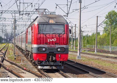 Leningrad Region, Russia - May 24, 2021: Russian Passenger Electric Locomotive Ep2k-035 With Passeng