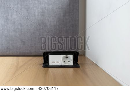 Closeup To Power Outlet At House Interior Wooden Floor. Equipment For Electricity Energy, Electrical