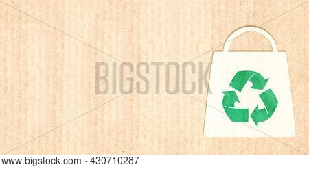 Responsible consumption. Arrows recycle symbol and shopping bag in paper cut style. Eco-friendly business. Horizontal banner with recycled eco paper texture. Copy space for text. Mock up template