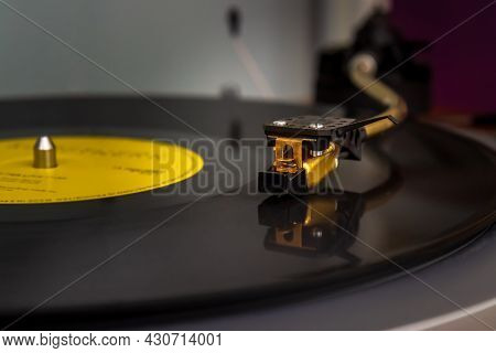 Vintage Turntable Vinyl Record Player. Close-up Of Needle On Vinyl Record. Selective Focus, Blurred