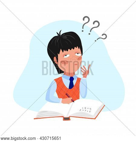 A Boy In A School Uniform Makes Homework. The Boy Is Studying. The Student Is Sitting With A Book.