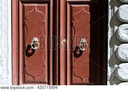 Door Knocker On The Entrance Of A House, Old Ornate Metal Door Handle, Italy