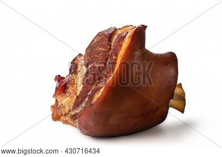 Appetizing golden smoked pork shank isolated on white background