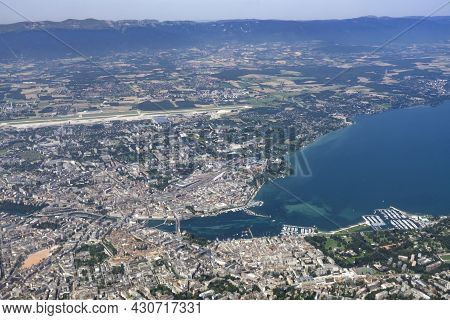 View From A Plane Window On Aerial Of Geneva And Lac Léman Or Lake Geneva That Is Located Between Fr