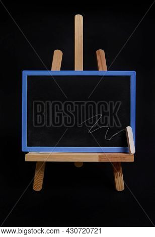 Close-up Studio Shot Of A Wooden Table Easel With A Chalk And Blackboard With Empty Blank Space For