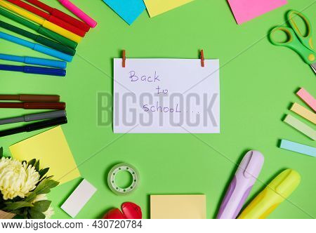 High Angle View Of Colorful Assortment Of Stationery Office Supplies And School Accessories Arranged