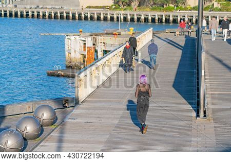 Wellington New Zealand - July 30 2021;hip Girl With Bright Purple Hair Walking Away And Others Walki