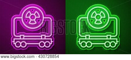 Glowing Neon Line Radioactive Cargo Train Wagon Icon Isolated On Purple And Green Background. Freigh