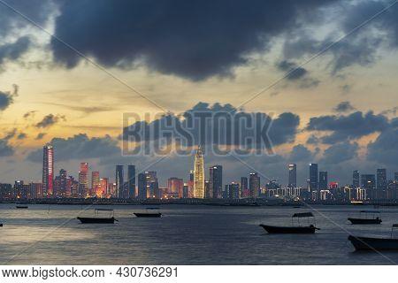 Skyline Of Shenzhen City, China Under Sunset. Viewed From Hong Kong Border Lau Fau Shan
