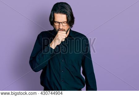 Middle age caucasian man wearing casual clothes and glasses feeling unwell and coughing as symptom for cold or bronchitis. health care concept.