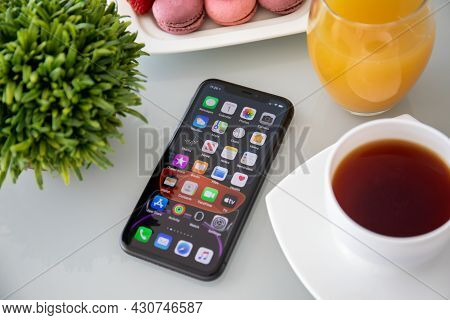 Anapa, Russia - October 1, 2019: Iphone 11 With Home Screen Ios 13 On The Table. Iphone 11 Was Creat