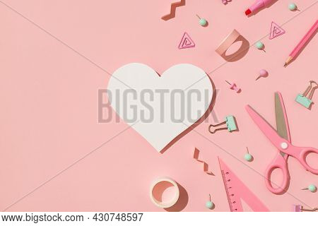 Top View Photo Of Pastel Pink And Green Stationery Adhesive Tapes Pushpins Binder Clips Scissors Pen