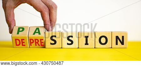 Passion Or Depression Symbol. Businessman Turns Wooden Cubes And Changes The Word Depression To Pass