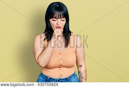 Young hispanic plus size woman wearing casual clothes feeling unwell and coughing as symptom for cold or bronchitis. health care concept.