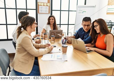 Group of hispanic business workers smiling happy working at the office