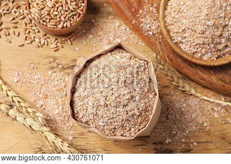 Wheat Bran On Wooden Table, Flat Lay