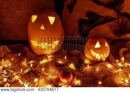 Halloween Pumpkins With Electric Illumination In Dark.