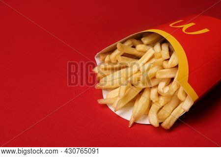 Mykolaiv, Ukraine - August 12, 2021: Big Portion Of Mcdonald's French Fries On Red Background, Close