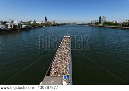 Cargo Ship With Scrap Metal Under The Severins Bridge On The Rhine In Cologne