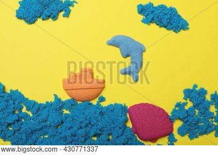 Sea Inhabitants Made Of Kinetic Sand On Yellow Background, Flat Lay