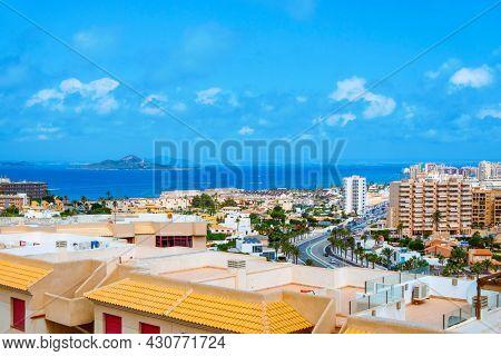 a view over La Manga del Mar Menor, in Murcia, Spain, with the Mar Menor lagoon and the Isla del Baron island on the left