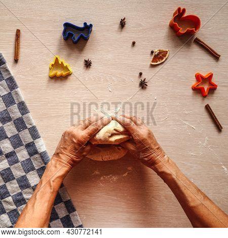 Senior Hands Knead The Dough On Table.