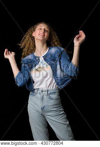 Happy Joyful Pretty Girl In Trendy Denim Outfit. Beautiful Curly Girl Wearing Jeans, Denim Jacket An