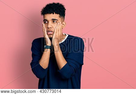 Young african american man wearing casual clothes tired hands covering face, depression and sadness, upset and irritated for problem