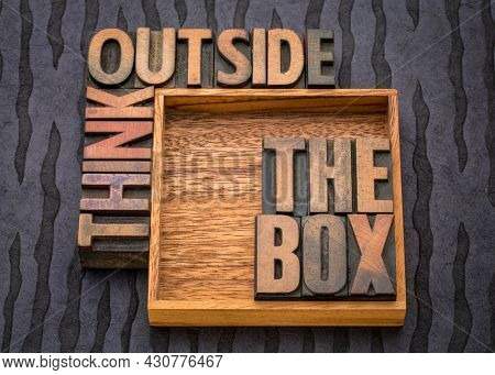 think outside the box concept- motivational phrase in vintage letterpress wood type, business, education, science and personal development concept
