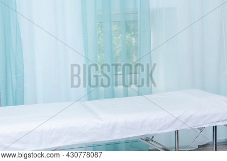 Office Interior In A Health Facility With Examination Table