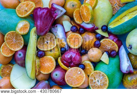 Variety Of Fresh Assorted Fruits On Blue Background. Assorted Fruits Colorful Background, Healthy Fr