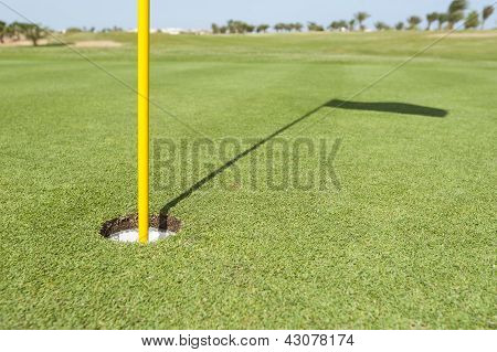 Base Of Flag Pole On Golf Green