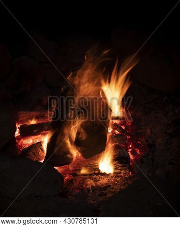 Night Campfire Being Blown By A Gentle Breeze