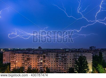 Thunderstorm With Lightning Above The Night City.
