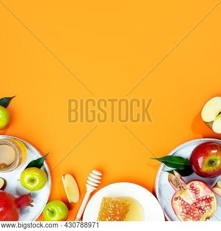 Honey, Apple And Pomegranate On A Orange Background. Concept Jewish New Year Happy Holiday Rosh Hash