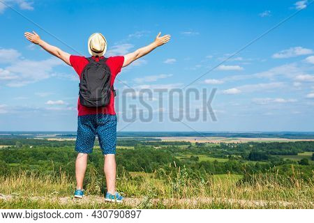 Tourist Man With Backpack Enjoying The View In Nature.traveler Man With Backpack,arms Outstretched S